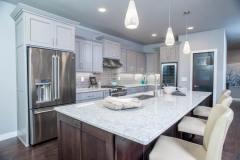 Kochmann Brothers Homes custom luxury kitchen  - photo by Area Women Magazine in Fargo