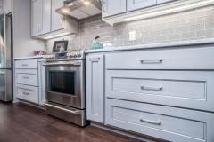 Kochmann Brothers Homes custom luxury kitchen range area  - photo by Area Women Magazine in Fargo