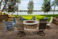Kochmann Brothers Homes custom luxury lake home patio fire ring