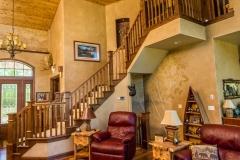 Kochmann Brothers Homes custom luxury lake home living room and stairs