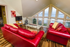 Kochmann Brothers Homes custom luxury lake home sitting room with windows to lake