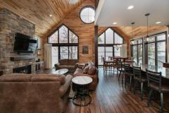 Kochmann Brothers Homes custom luxury lake home living room view of lake