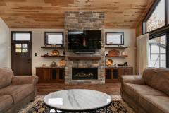 Kochmann Brothers Homes custom luxury lake home living room with fireplace