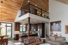 Kochmann Brothers Homes custom luxury lake home living room with balcony