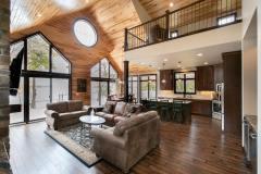 Kochmann Brothers Homes custom luxury lake living room with view of lake