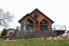 Kochmann Brothers Homes custom luxury lake exterior with deck