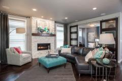 Kochmann Brothers Homes custom luxury living room - photo by Area Women Magazine