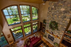 Kochmann Brothers Homes custom luxury living room lake home with stone fireplace