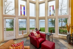 Kochmann Brothers Homes custom luxury living room overlooking lake