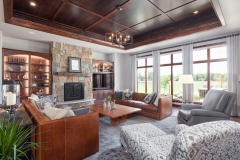 Kochmann Brothers Homes custom luxury living room with custom wood ceiling