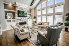 Kochmann Brothers Homes custom luxury living room with large windows and fireplace