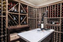 Kochmann Brothers Homes custom luxury wine cellar - photo by Area Women Magazine in Fargo