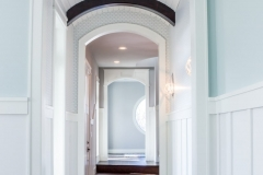 Kochmann Brothers Homes custom luxury  arched hallway bright white