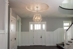Kochmann Brothers Homes custom luxury entry with chandelier