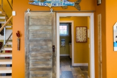 Kochmann Brothers Homes custom luxury sliding barn door at lake home